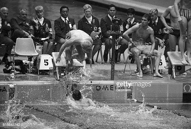 USA's Mark Spitz no sooner touches the wall than teammate Don Schollander dives out over him to cinch a US gold medal in the men's 800meter freestyle...