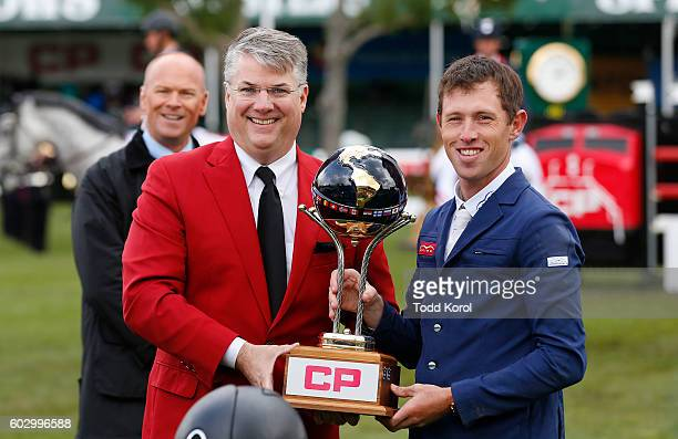 CP's Mark Wallace hands Scott Brash of Great Britain his winning trophy after he won the Spruce Meadows CP International Grand Prix on September 11...