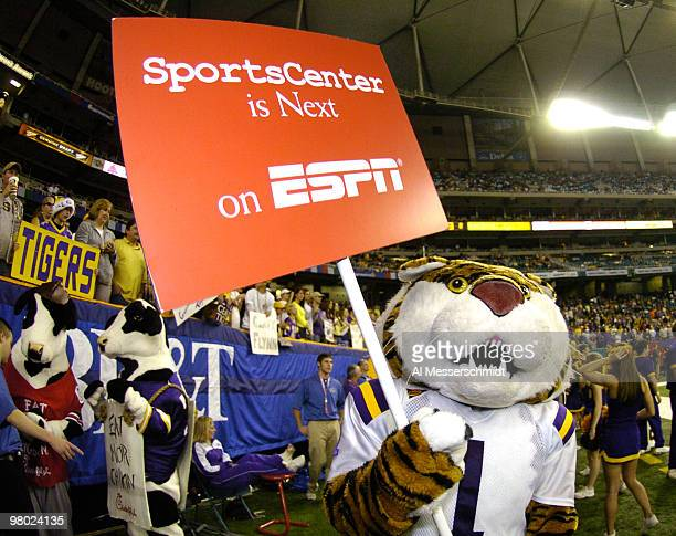 LSU's mascot a tiger carries an ESPN sign before play against the University of Miami during the 2005 ChickfilA Peach Bowl at the Georgia Dome in...