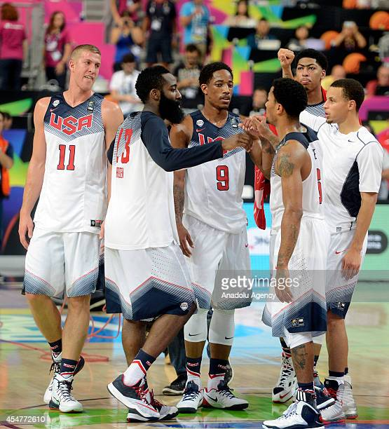 USA's Mason Plumlee James Harden Demar DeRozan and Derrick Rose celebrate at the end of the 2014 FIBA Basketball World Cup Round of 16 match between...