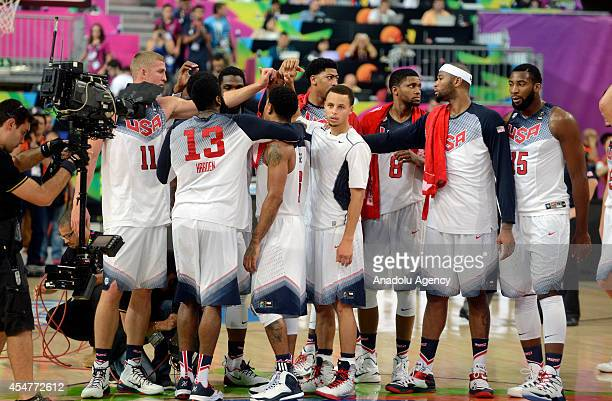 USA's Mason Plumlee James Harden Derrick Rose Rudy Gay DeMArcus Cousins and Andre Drummond celebrate at the end of the 2014 FIBA Basketball World Cup...