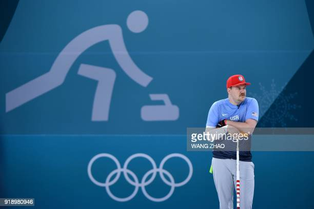 TOPSHOT USA's Matt Hamilton watches the curling men's round robin session between Denmark and the US during the Pyeongchang 2018 Winter Olympic Games...