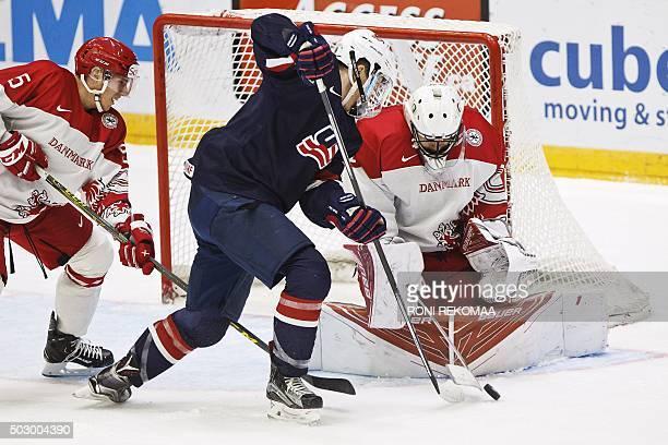 USA's Matthew Tkachuk tries to score past Denmark's Mathias Lassen and goalkeeper Mathias Seldrup during the 2016 IIHF World Junior Ice Hockey...