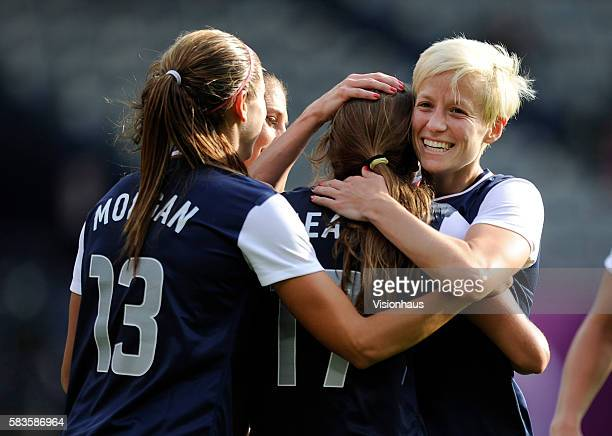 USA's Megan Rapinoe Alex Morgan and Tobin Heath celebrate their fourth goal during the womens Group G football match between USA and France as part...