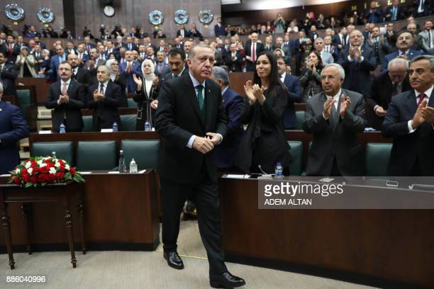 AKP's members of parliament applaud President of Turkey and Leader of the Justice and Development Party Recep Tayyip Erdogan after his speech during...