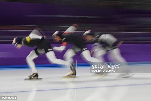 USA's Mia Manganello USA's Brittany Bowe and USA's Heather Bergsma compete in the women's team pursuit quarterfinal speed skating event during the...