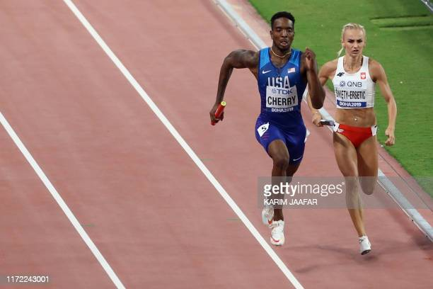 USA's Michael Cherry and Poland's Justyna SwietyErsetic compete in the Mixed 4 x 400m Relay final at the 2019 IAAF World Athletics Championships at...