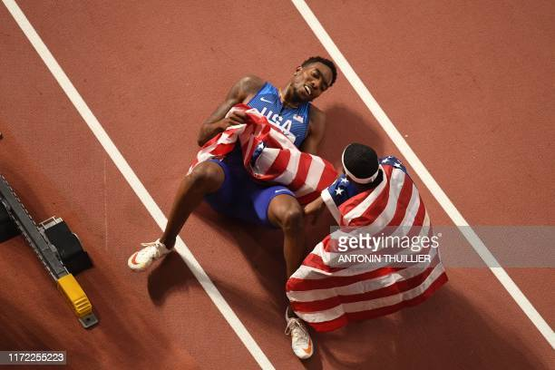 USA's Michael Cherry and USA's Wilbert London celebrate winning the Mixed 4 x 400m Relay final at the 2019 IAAF World Athletics Championships at the...