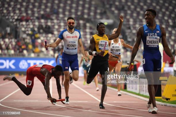 USA's Michael Cherry finishes ahead of Jamaica's Javon Francis and Bahrein's Abbas Abubakar Abbas in the Mixed 4 x 400m Relay final at the 2019 IAAF...