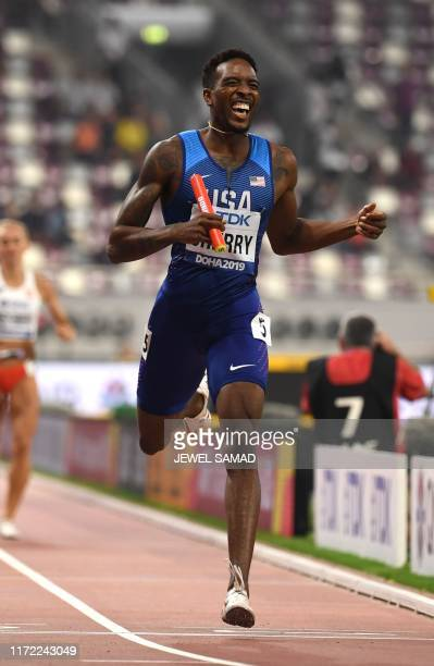 USA's Michael Cherry finishes first in the Mixed 4 x 400m Relay final at the 2019 IAAF World Athletics Championships at the Khalifa International...