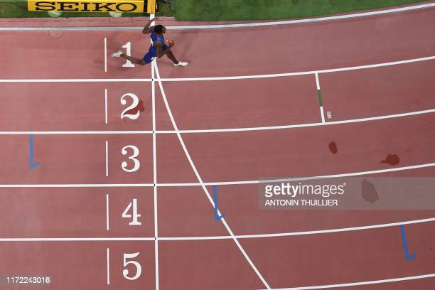 USA's Michael Cherry finishes in the Mixed 4 x 400m Relay final at the 2019 IAAF World Athletics Championships at the Khalifa International Stadium...