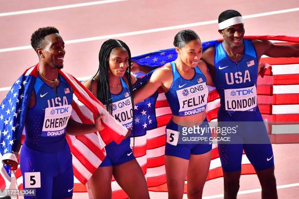 USA's Michael Cherry USA's Courtney Okolo USA's Allyson Felix and USA's Wilbert London pose after winning the Mixed 4 x 400m Relay final at the 2019...