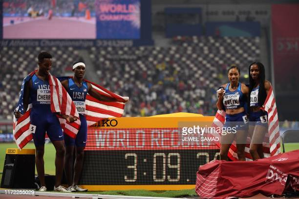 USA's Michael Cherry USA's Wilbert London USA's Allyson Felix and USA's Courtney Okolo celebrate after setting a world record in the Mixed 4 x 400m...