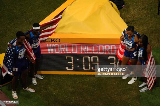TOPSHOT USA's Michael Cherry USA's Wilbert London USA's Allyson Felix and USA's Courtney Okolo celebrate after setting a world record in the Mixed 4...