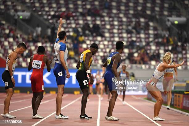 USA's Michael Cherry waits to receive the baton in the Mixed 4 x 400m Relay final at the 2019 IAAF World Athletics Championships at the Khalifa...