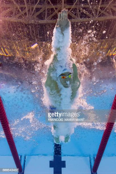 TOPSHOT USA's Michael Phelps competes in a Men's 100m Butterfly heat during the swimming event at the Rio 2016 Olympic Games at the Olympic Aquatics...