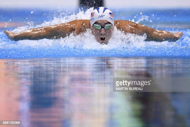 TOPSHOT USA's Michael Phelps competes in a Men's 200m Individual Medley heat during the swimming event at the Rio 2016 Olympic Games at the Olympic...
