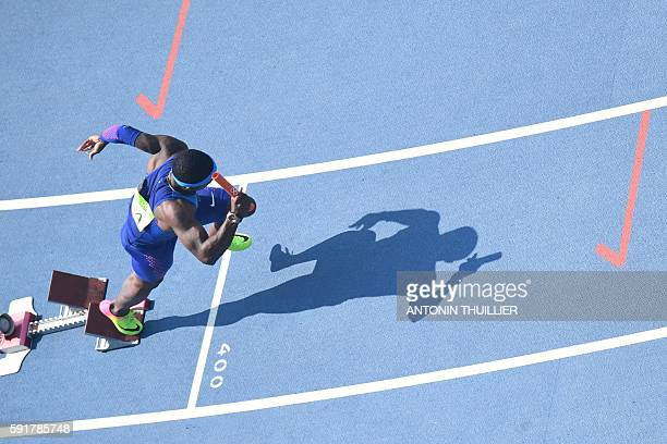 USA's Michael Rodgers competes in the Men's 4 x 100m Relay Round 1 during the athletics event at the Rio 2016 Olympic Games at the Olympic Stadium in...