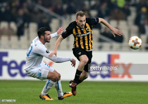 AEK's Michalis Bakakis fights for the ball with Rijeka's Alexander Gorgon during the UEFA Europa League Group D football match between AEK Athens and...