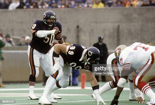 CHICAGO IL CIRCA 1980's Middle Linebacker Mike Singletary and defensive end Dan Hampton of the Chicago Bears in action against the San Francisco...