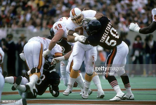 CHICAGO IL CIRCA 1980's Middle Linebacker Mike Singletary of the Chicago Bears is blocked by left guard Steve Courson of the Tampa Bay Buccaneers...
