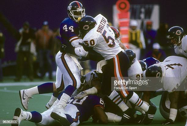 RUTHERFORD NJ CIRCA 1980's Middle Linebacker Mike Singletary of the Chicago Bears wraps up running back Maurice Carthon of the New York Giants during...
