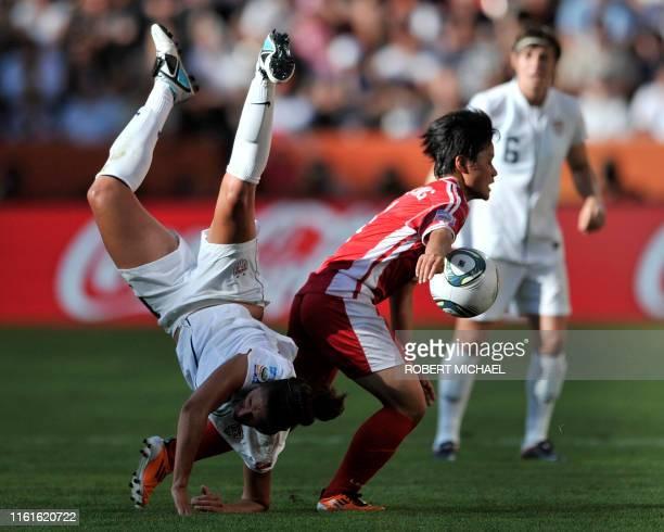 USA's midfielder Carli Lloyd and North Korea's midfielder Kim Su Gyong vie for the ball during the football match of the FIFA women's football World...