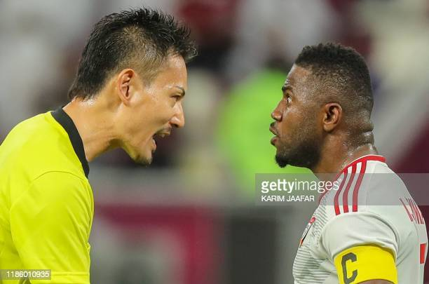S midfielder Ismail al-Hammadi argues with japanese referee Ryuji Sato during the 24th Arabian Gulf Cup Group A football match between Qatar and the...