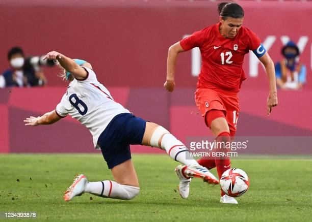 S midfielder Julie Ertz tackles Canada's forward Christine Sinclair during the Tokyo 2020 Olympic Games women's semi-final football match between the...