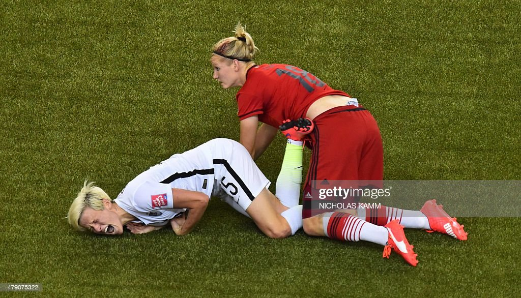 USA's midfielder Megan Rapinoe yells after being tackled by Germany's forward Alexandra Popp during their 2015 FIFA Women's World Cup semifinal match at Olympic Stadium in Montreal on June 30, 2015.