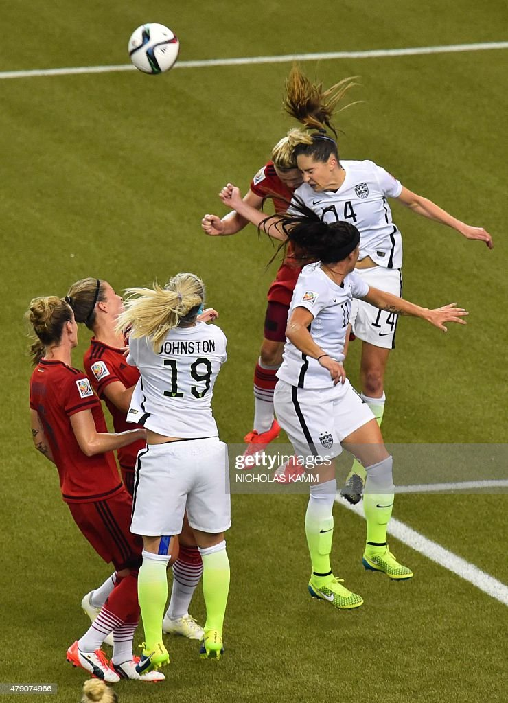 USA's midfielder Morgan Brian (R top) collides with Germany's forward Alexandra Popp during their 2015 FIFA Women's World Cup semifinal match at Olympic Stadium in Montreal on June 30, 2015.
