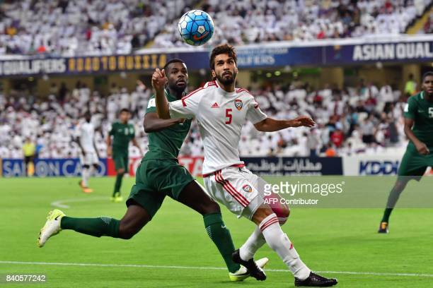 UAE's midfielder Tareq Ahmed vies for the ball with Saudi's defender Mansoor AlHarbi during the 2018 FIFA World Cup qualifier football match between...