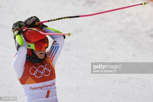 TOPSHOT USA's Mikaela Shiffrin reacts as she crosses the finish line to win gold in the Women's Giant Slalom at the Yongpyong Alpine Centre during...
