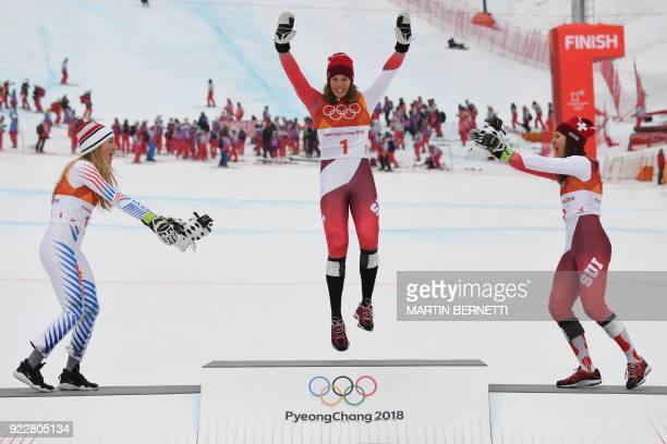 TOPSHOT USA's Mikaela Shiffrin silver Switzerland's Michelle Gisin gold and Switzerland's Wendy Holdener bronze celebrate during the victory ceremony...