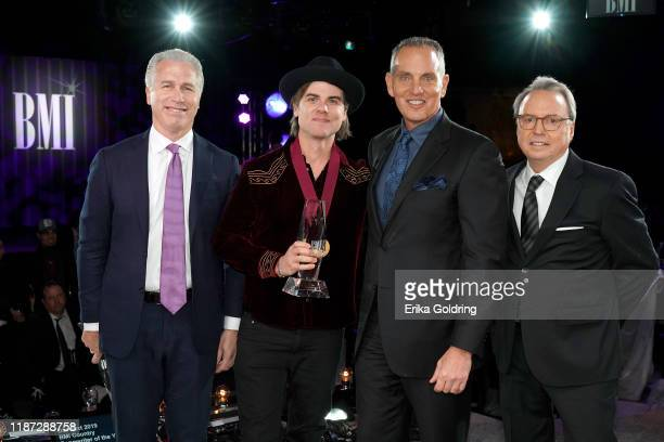 BMI's Mike Steinberg Ross Copperman BMI President/CEO Mike O'Neill and BMI Vice President Creative Jody Williams attend as BMI presents Dwight Yoakam...
