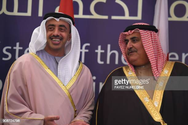 UAE's Minister of Foreign Affairs and International Cooperation Sheikh Abdullah bin Zayed bin Sultan al Nahyan speaks with his Bahraini counterpart...