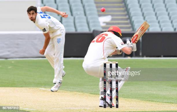 NSW's Mitchell Starc bounces SA's Tom Cooper during day three of the Sheffield Shield match between South Australia and New South Wales at the...