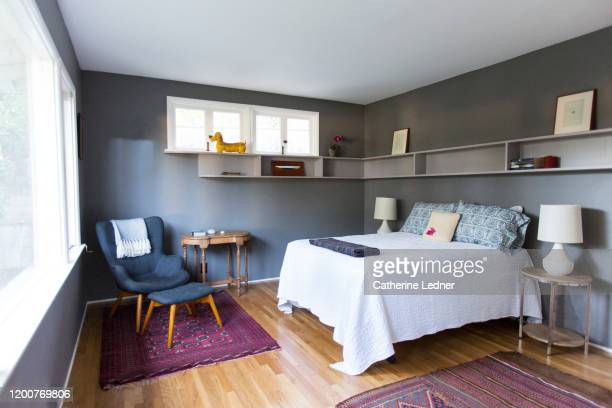 50's modern bedroom painted grey, very neat, clean and sparse. - tidy room stock pictures, royalty-free photos & images