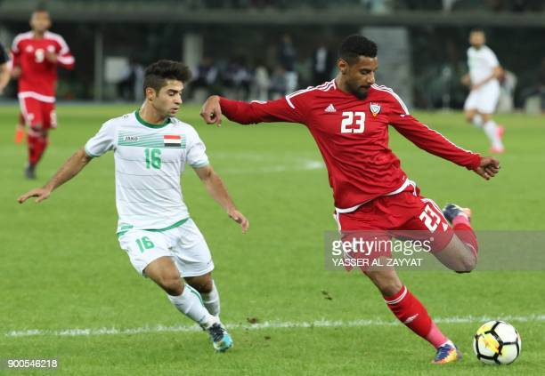 UAE's Mohamed Ahmed kicks the ball as Iraq's Hussein Ali alSaedi defends during the 2017 Gulf Cup of Nations semifinal football match between Iraq...