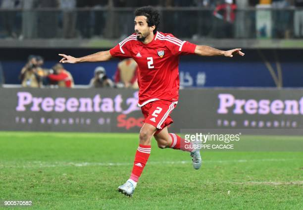 UAE's Mohammed Barqesh celebrates after scoring a penalty during the 2017 Gulf Cup of Nations semifinal football match between Iraq and the UAE at...
