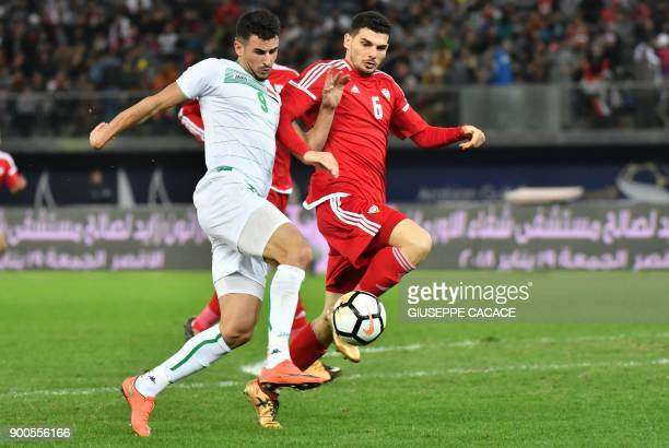 UAE's Mohanad Salem fights for the ball against Iraq's Aymen Hussein during the 2017 Gulf Cup of Nations semifinal football match between Iraq and...