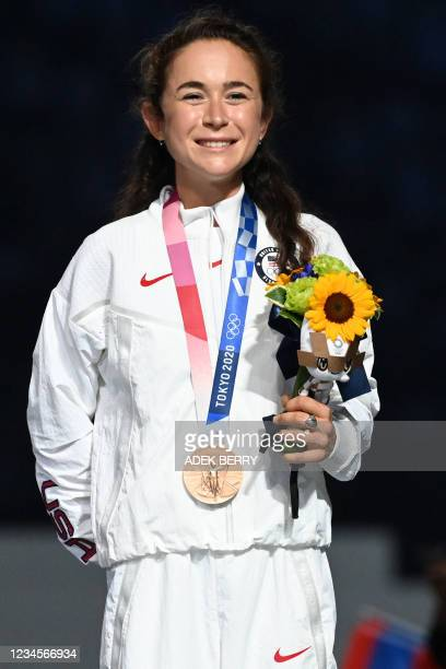 S Molly Seidel poses with her bronze medal during the victory ceremony of the women's marathon event during the Tokyo 2020 Olympic Games at the...