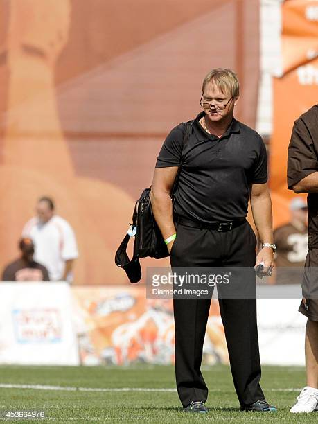 ESPN's Monday Night Football Analyst and former NFL head coach Jon Gruden watches the action from the sideline during a training camp practice on...