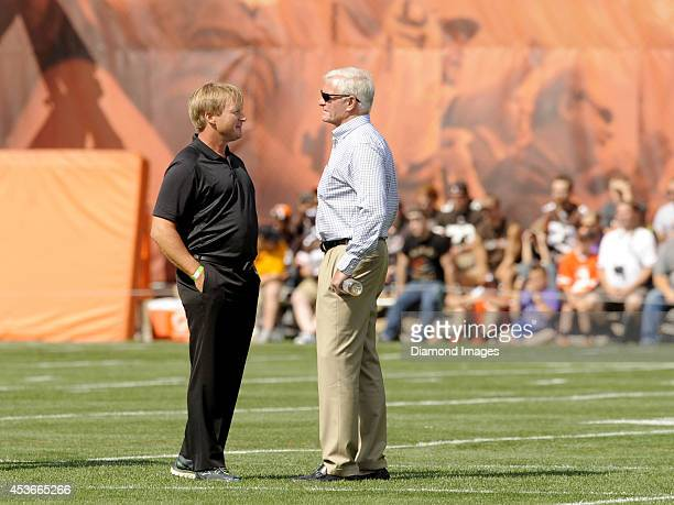 ESPN's Monday Night Football Analyst and former NFL head coach Jon Gruden talks with owner Jimmy Haslam of the Cleveland Browns the sideline during a...