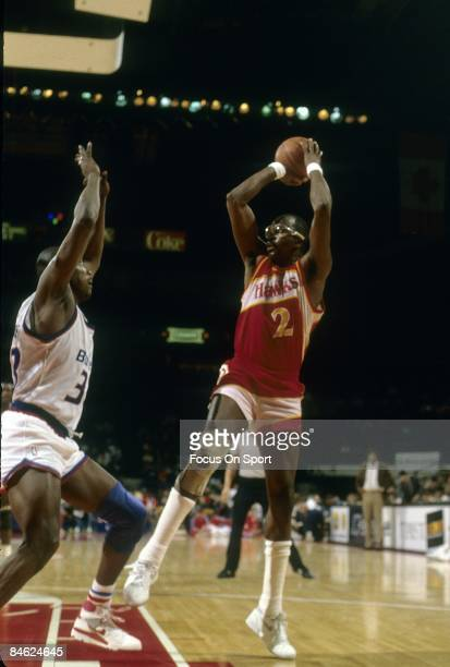BALTIMORE MD CIRCA 1980's Moses Malone of the Altanta Hawks shoots over Terry Catledge of the Washington Bullets during a late circa 1980's NBA...