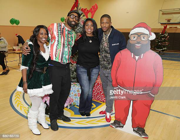 YG's mother Shonee Jackson Baron Davis Mayor Aja Brown and YG attend the Compton Christmas Winter Wonderland And Toy Giveaway hosted by Mayor Aja...