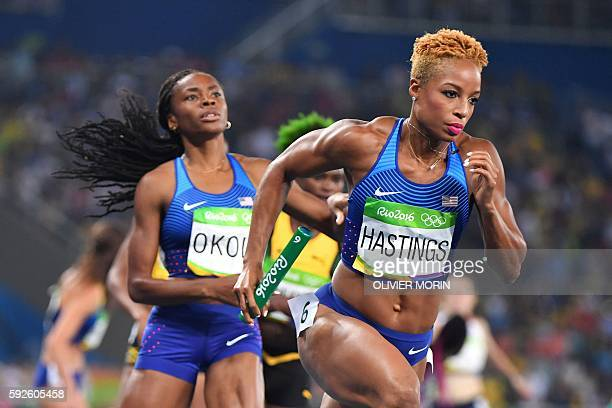 S Natasha Hastings runs with the baton in the Women's 4x400m Relay Final during the athletics event at the Rio 2016 Olympic Games at the Olympic...
