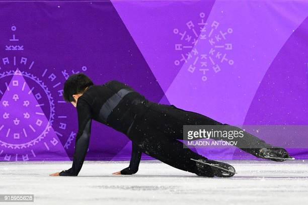 TOPSHOT USA's Nathan Chen falls as he competes in the figure skating team event men's single skating short program during the Pyeongchang 2018 Winter...