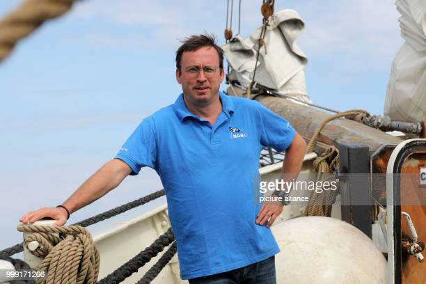 NABU's National Director Leif Miller standing on board the traditional sail boat 'Ryvar' after a press conference where he presented the 10day sail...