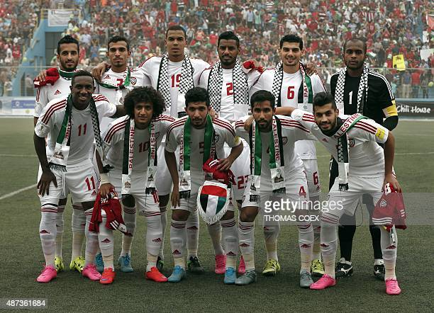 UAE's national football team poses before the 2018 FIFA World Cup qualifying football match between Palestine and UAE at the Faisal alHusseini...